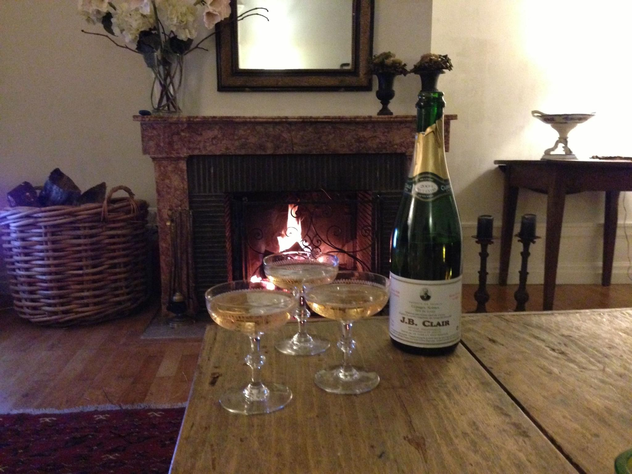 Log fire at Maison Les Bardons en enjoying champagne from J.b. Clair